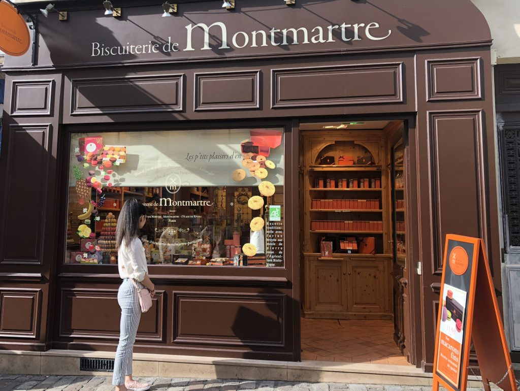 Woman in front of Biscuiterie de Montmarte - Paris Vacation