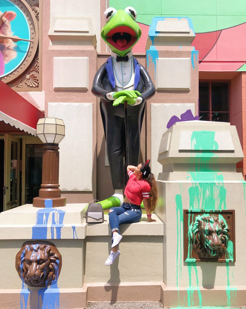 Woman in front of Disney World The Muppets Store