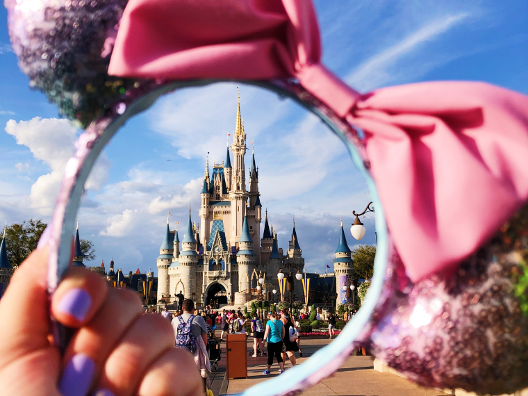 Up close Photo of Disney World Cinderella Castle through Minnie Mouse Ears.